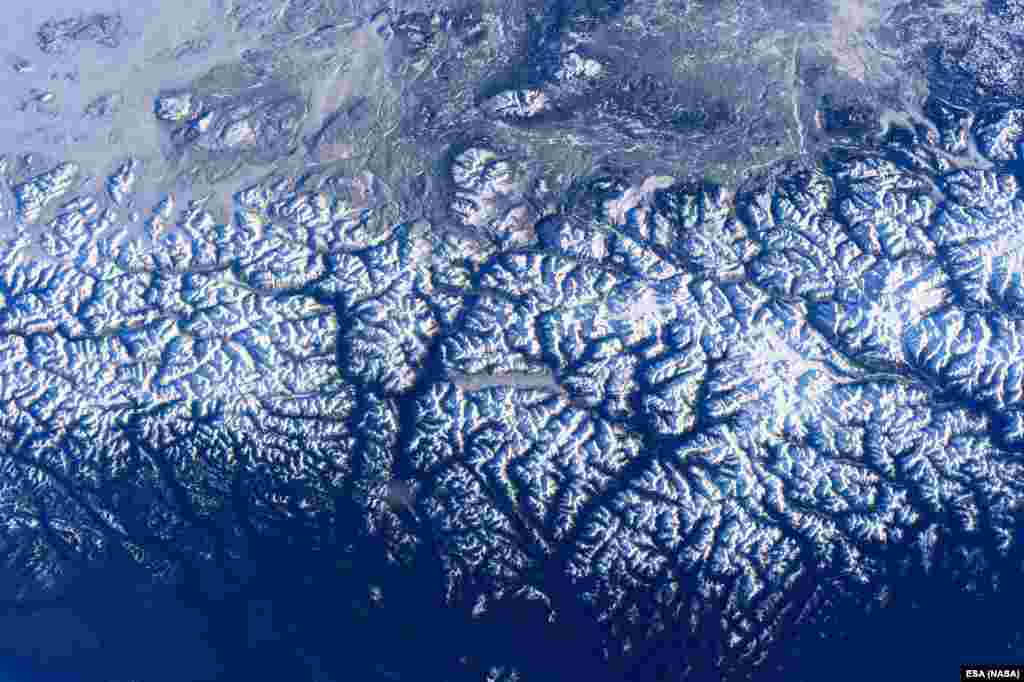ESA astronaut Tim Peake took this photograph over the west coast of Canada from the International Space Station on Dec. 31, 2015, and shared it with his Twitter followers on Jan. 5, 2016. The photograph shows Canada's Coast Range of mountains, with King Island and Burke Channel in the center. The Pacific Ocean is visible at the bottom and north is to the left.