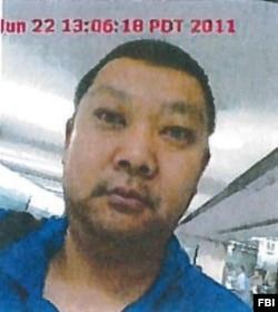 Su Bin 持有中国护照并拥有加拿大永久居民身份 这是他2011年入境美国时的照片