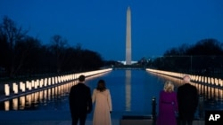 President-elect Joe Biden and his wife Jill Biden are joined by Vice President-elect Kamala Harris and her husband Doug Emhoff in a COVID-19 memorial event at the Lincoln Memorial Reflecting Pool, in Washington, Jan. 19, 2021.