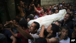 People carry the body of Sayed Tafshan, who died during clashes between security forces and residents of al-Waraq island, on the southern fringes of Cairo, Egypt, July 16, 2017.