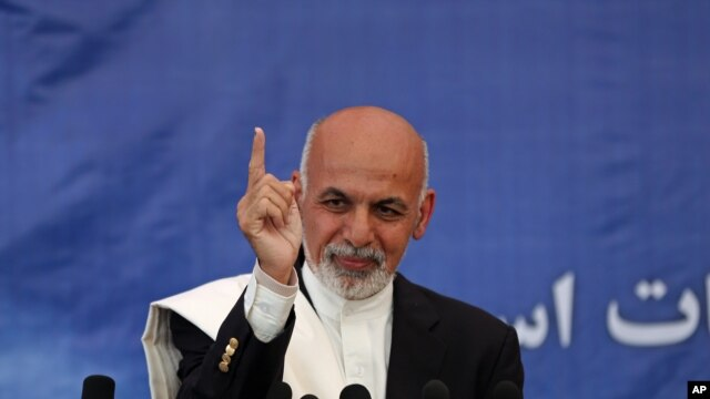 Afghan presidential candidate Ashraf Ghani Ahmadzai addresses a news conference in Kabul, Afghanistan, Thursday, May 15, 2014
