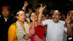 Bangladeshi activists celebrate the execution of two war criminals Nov. 22, 2015, in Dhaka, Bangladesh.