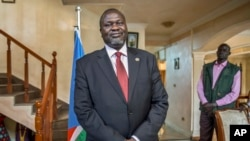FILE - South Sudan's rebel leader Riek Machar speaks about the situation in South Sudan following last week's peace agreement with the government, in Addis Ababa, Ethiopia, Aug. 31, 2015.