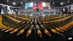 Bullets are lined up in front of a U.S. made F-16V fighters during a military exercise in Chiayi County, southern of Taiwan, Jan. 15, 2020.