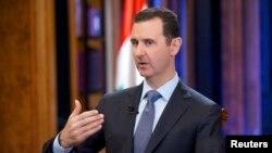 지난 달 19일 시리아 관영TV에 출연한 바샤르 알 아사드 시리아 대통령. (자료사진)