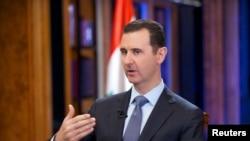 Presiden Suriah Bashar al-Assad dalam sebuah wawancara televisi di Damaskus, 2013.