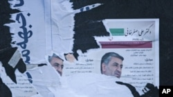 Torn electoral posters are seen on a wall in central Tehran, March 3, 2012.