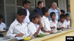 Students at En Komar Primary School in Kampong Thom province have receive breakfast on Tuesday, June 10, 2014. The breakfasts are part of a World Food Program initiative that aims to feed 3.5 million students by 2016.