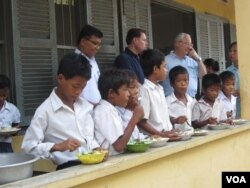 Students at a primary school in Kampong Thom province, Cambodia, receive breakfast as part of a World Food Program, 2014