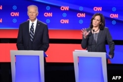 Democratic presidential hopeful U.S. Senator from California Kamala Harris delivers her closing statement flanked by former Vice President Joe Biden during the Democratic primary debate hosted by CNN at the Fox Theatre in Detroit, July 31, 2019.