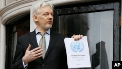 "WikiLeaks founder Julian Assange speaks on the balcony of the Ecuadorean Embassy in London, Friday, Feb. 5, 2016. A U.N. human rights panel says Assange has been ""arbitrarily detained"" as he fights a warrant to answer rape charges in Sweden."