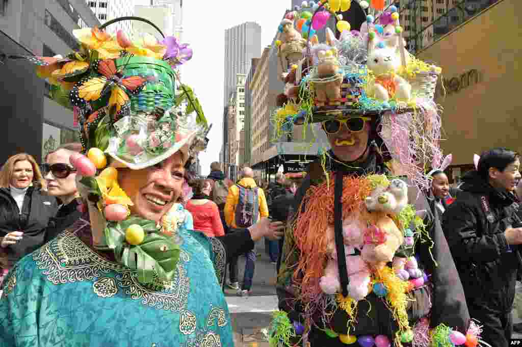 People show off their Easter finery as they walk down Fifth Avenue in New York during the annual Easter Parade and Easter Bonnet Festival.