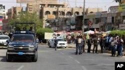 Lực lượng an ninh Iraq phong toả hiện trường một vụ đánh bom tự sát ở phía đông Baghdad, Iraq, 27/9/2016.