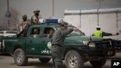 افغان پولیس د ټاکنو د کمیسیون دفتر سره د برید په مهال