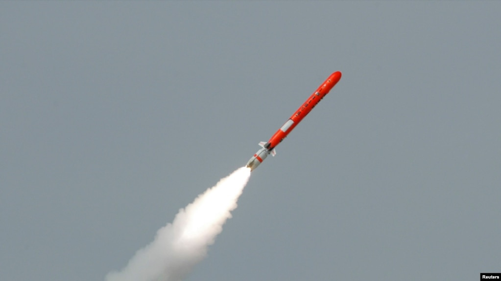 FILE - Pakistan's Babur Hatf VII cruise missile takes off during a test flight from an undisclosed location, July 26, 2007.