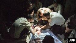 7月13日叙利亚人悼念一位中弹身亡的同胞