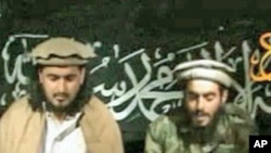 FILE - Humam Khalil Abu Mulal al-Balawi (r) and Hakimullah Mehsud, the new leader of the Taliban in Pakistan.