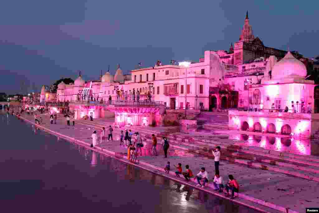 Temples and other buildings on the bank of Sarayu river are seen illuminated ahead of the foundation-laying ceremony for a Hindu temple in Ayodhya, India, Aug. 4, 2020.