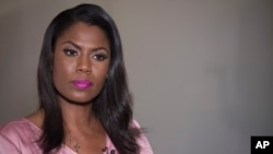 FILE - Former White House staffer Omarosa Manigault Newman listens during an interview with The Associated Press, Aug. 14, 2018, in New York.