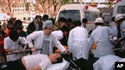 FILE - Subway passengers affected by sarin gas spread in the central Tokyo subways by the Aum Shinrikyo doomsday cult are carried into St. Luke's International Hospital in Tokyo, March 20, 1995. The Japanese cult was popular in Russia in the 1990s but was outlawed.