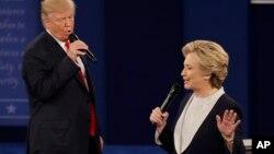 FILE - Republican presidential nominee Donald Trump and Democratic presidential nominee Hillary Clinton speak during the second presidential debate at Washington University in St. Louis, Sunday, Oct. 9, 2016. (AP Photo/Patrick Semansky)