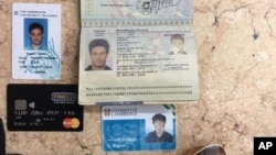 In this photo released by the Egyptian Ministry of Interior March 24, 2016, personal belongings of slain Italian graduate student Giulio Regeni, including his passport, are displayed.
