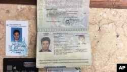 FILE - In this photo released by the Egyptian Ministry of Interior on Thursday, March 24, 2016, personal belongings of slain Italian graduate student Giulio Regeni, including his passport, are displayed.