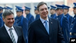 Serbia's Prime Minister Aleksandar Vucic (R), accompanied by Bosnian Prime Minister Denis Zvizdic, inspect the honor guard during an official welcoming ceremony in Sarajevo, Bosnia, Nov. 4, 2015.