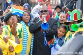 ANC mayor of Port Elizabeth Zanoxolo Wayile, center, blows a trumpet before the 2010 soccer World Cup… The DA blames costs associated with the tournament for a financial crisis in the city