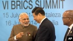 中國國家主席習近平與莫迪2014年7月15日在巴西金磚國家領導人會晤中見面。