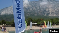 Club Med banner blows in the wind on the dock at the Club Med Beldi vacation resort in Beldibi, Turkey, June 22, 2009.
