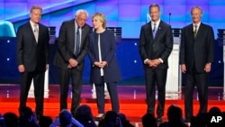 Democratic presidential candidates, from left, Jim Webb, Bernie Sanders, Hillary Clinton, Martin O'Malley and Lincoln Chafee, take the stage before the CNN Democratic presidential debate in Las Vegas, Oct. 13, 2015.
