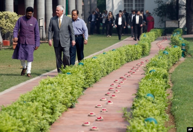 U.S. Secretary of State Rex Tillerson walks along side the path of the last steps of Mahatma Gandhi to the Martyr's Column, the site of the assassination Mahatma Gandhi, with director Dipankar Gyan, at the Gandhi Smriti, Oct. 25, 2017, in New Delhi, India.