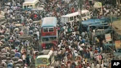 Bicycles rickshaws, buses and pedestrians jam a street in Dhaka, the capital of Bangladesh, the world's most densely populated nation, Aug. 5, 1994