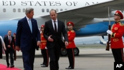 U.S. Secretary of State John Kerry, left, and Georgia's Foreign Minister Mikheil Janelidze walk upon arrival at Tbilisi International Airport, Georgia, July 6, 2016.
