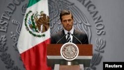 Mexico's President Enrique Peña Nieto delivers a message at the National Palace in downtown Mexico City, Oct. 6, 2014.
