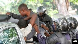 Young men suspected of being militant supporters of opposition candidate Etienne Tshisekedi are forced into a police truck as they are arrested near opposition party headquarters in the Limete district of Kinshasa, Congo, December 12, 2011.