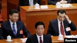 Chủ tịch Trung Quốc Tập Cận Bình (trái) tại phiên khai mạc kỳ họp Quốc hội hôm 5/3
