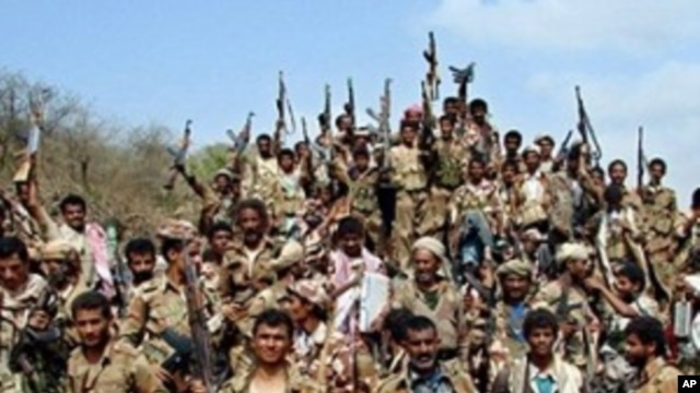 Yemeni soldiers and tribe members after a battle against al-Houthi Shiite rebels in northern Yemen. Saudi Arabia's Deputy Defense Minister said the rebels have been forced over the border back into Yemen (file photo)