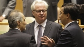Syria's U.N. Ambassador Bashar Ja'afari (L), speaks to Russia's U.N. Ambassador Vitaly Churkin (C), and China's deputy U.N. Ambassador Wang Min before the United Nations General Assembly passed a draft resolution condemning Syria, at the United Nations in