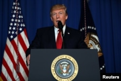 FILE - U.S. President Donald Trump delivers a statement about missile strikes on a Syrian airbase, at his Mar-a-Lago estate in West Palm Beach, Fla., April 6, 2017.