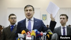 Ukrainian opposition figure and Georgian former President Mikheil Saakashvili, center, addresses the media inside a court building in Kiev, Ukraine, Jan. 3, 2018.