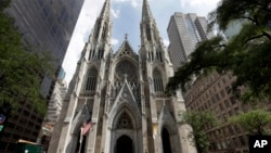 FILE - This Sept. 6, 2018, photo shows St. Patrick's Cathedral in New York. A New Jersey man has been arrested outside the cathedral with two jugs of gasoline.