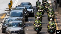 Traffic police on motorcycles ride in formation during a visit by the Chinese President in Hong Kong, June 29, 2017.