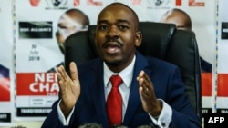 Zimbabwe's Movement for Democratic Change (MDC) party leader Nelson Chamisa holds a press conference at the MDC headquarters in Harare, on July 17, 2018, over the security of the ballot paper and credibility of the voters roll ahead of general elections on July 30. Chamisa said his party will write to the Southern African Development Community (SADC) to intervene to resolve the stalemate with the Zimbabwe Electoral Commission (ZEC). / AFP PHOTO / Jekesai NJIKIZANA