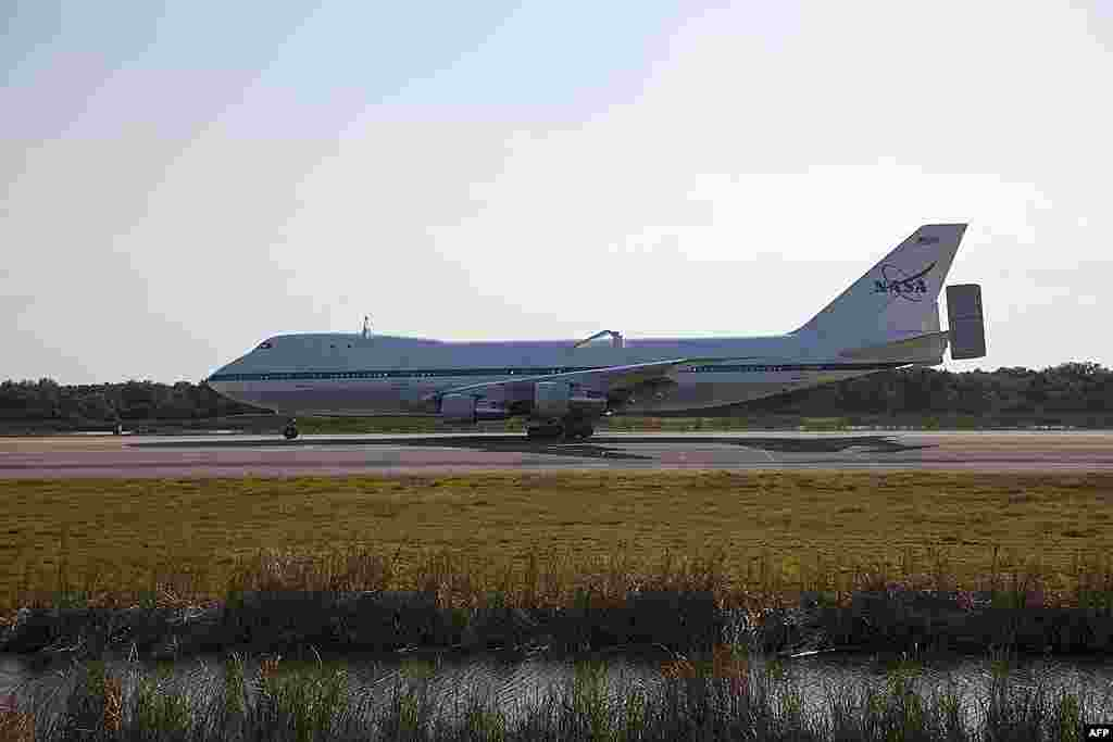The Shuttle Carrier Aircraft arrives at the Shuttle Landing Facility at NASA's Kennedy Space Center in Florida to prepare for space shuttle Discovery's ferry flight to Virginia, April 10, 2012 . (NASA)