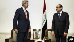 2014年6月23日美国国务卿约翰·克里(左)会见伊拉克总理马利基
