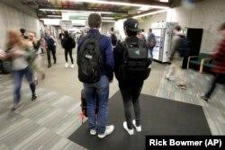 In this November 14, 2019, photo, students walk on the campus of Utah Valley University, in Orem, Utah.