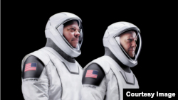 NASA astronauts Doug Hurley, left, and Robert Behnken, right, are shown in their official SpaceX space suits. (SpaceX/Flickr)