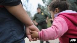 FILE - U.S. Border Patrol agents take Central American immigrants into custody near McAllen, Texas, Jan. 04, 2017.